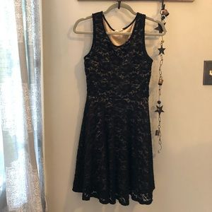 Black and nude lace swing dress